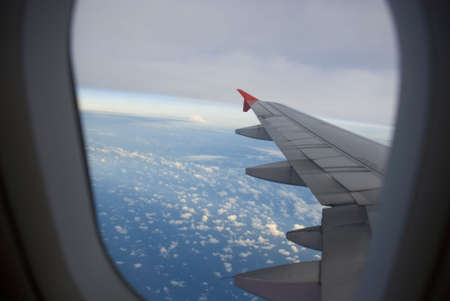 Boeing Plane wings - blue sea view, window Stock Photo
