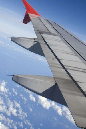 Boeing Plane wings - blue sea view, tilted photo