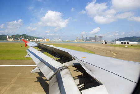 Landing, Plane wing - runway for airport photo