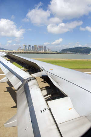 Landing, Plane wing - runway for airport Stock Photo - 3370124