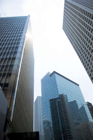 pictorial  representation: Three point low angle view of office building in urban area - Hong Kong Stock Photo