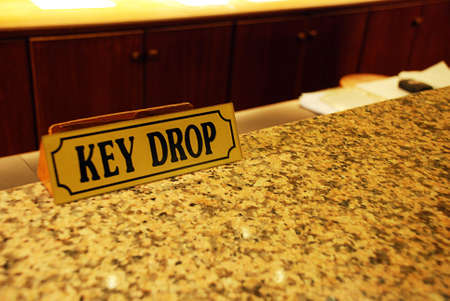 Key drop at the hotel reception counter photo