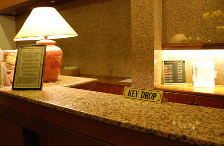 Key drop at the hotel reception counter