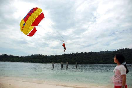 Parachuting beach sports - young asian girl looking Stock Photo