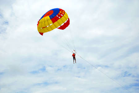 travel features: Parachuting - Parachute on sky background