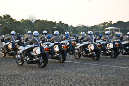 patrolling: Indonesian police patrolling on bike Stock Photo