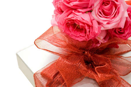 Flowers and red ribbon gift Stock Photo