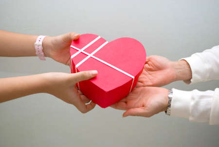 give hand: Gift giving, heart shape box