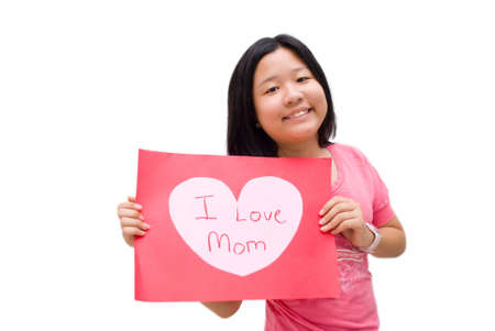 Girl in pink shirt, with i love mom message board on white background Stock Photo - 4411566