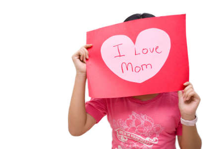 Girl in pink shirt, with i love mom message board on white background photo