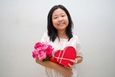 Girl with love or heart shaped gift box and flowers Stock Photo - 4411709