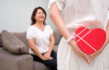 Mother excited to see surprise gift Stock Photo - 4411570