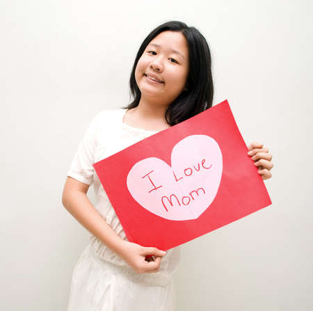 Girl with I love mom message board Stock Photo - 4411562