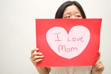 I love mom suspicious girl Stock Photo