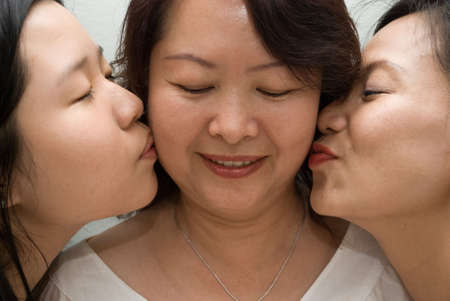 Kissing mother photo