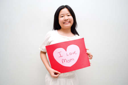 Girl with I love mom message board photo