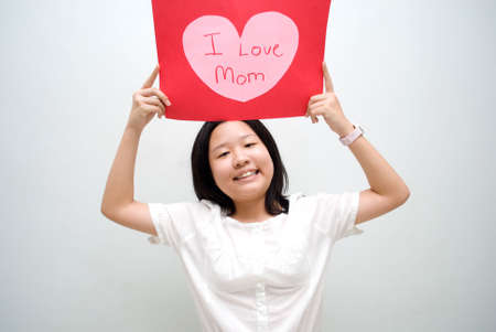 Girl raising hand with love message for mum Stock Photo - 4411582