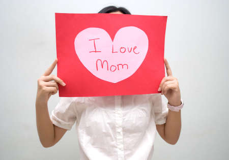 Girl with red message for mum Stock Photo - 4411698