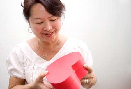 Happy receiving heart shape box gift Stock Photo - 4411723