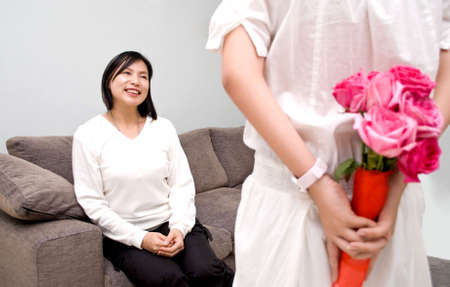 Surprising mum with roses Stock Photo - 4426783