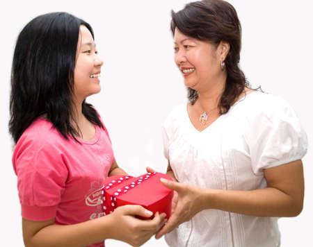 kinfolk: Asian lady giving gift Stock Photo
