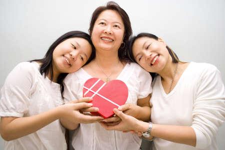 Asian girls gave mum gift photo