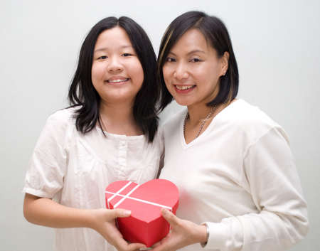 girl and mum posing with gift photo