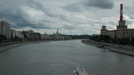 View of the Moscow River Embankment and Moscow State University in the summer. Moscow, Russia. 4k. Other camera movements, raw flat color, frame rates, formats, and resolutions are available upon request. Standard-Bild