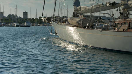 Sailing superyacht moored in marina at sunset 4k. Other camera movements, raw flat color, frame rates, formats, and resolutions are available upon request.