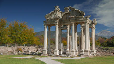 approached: APHRODISIAS ARCHEOLOGICAL SITE, AYDIN, TURKEY - NOVEMBER 15, 2015: Ancient ruins of Aphrodisias. Tetrapylon gate was the monumental gateway which greeted pilgrims when they approached the Temple of Aphrodite.