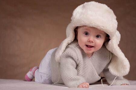The little girl in a winter hat photo