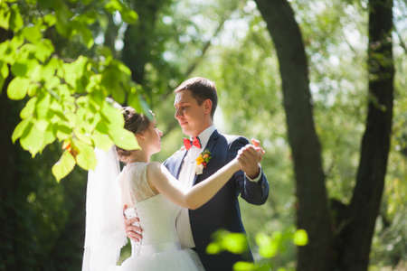 Happy couple dancing in green park photo