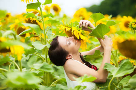 happy couple in love having fun in field full of sunflowers. wedding couple. cheerful woman and man. love concept. freedom photo