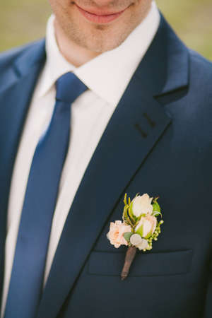 corsage: wedding corsage on suit of man Stock Photo