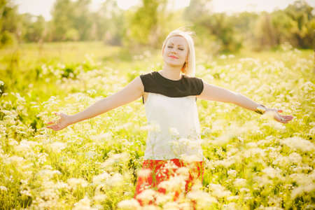Young  business woman having fun outside after hard day in office. Freedom concept. Lady in spring or summer meadow. Free happy girl. Successful person. Success. Businesswoman with arms outstretched.