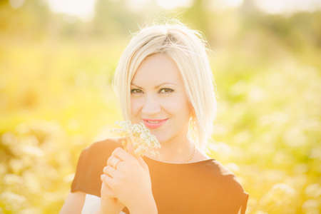 hard day at the office: Young  business woman with field flowers in hands outside after hard day in office. Freedom concept. Lady having fun in spring or summer meadow. Free happy girl portrait. Successful person. Success.