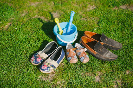 Family shoes. Parent and child shoes. Three pairs of shoes in father big, mother medium and small kid size photo