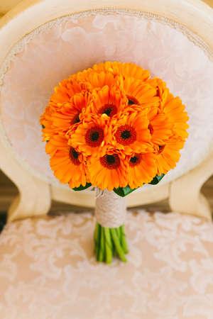 color photo: Beautiful wedding bouquet of orange flowers. No people. Vertical color photo.
