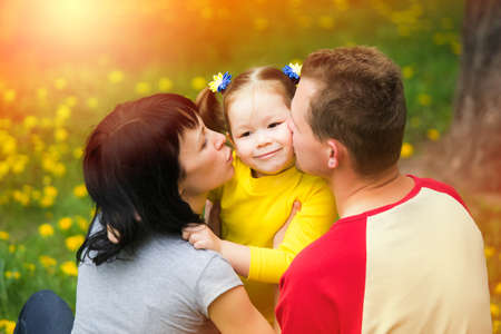 boy and girl hug: Young family spending time outdoor on a summer day. Stock Photo