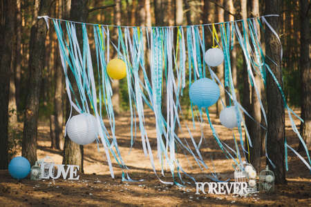 outdoor photo: Beautiful place for outside wedding ceremony in wood. Wedding settings. Horizontal image. Stock Photo