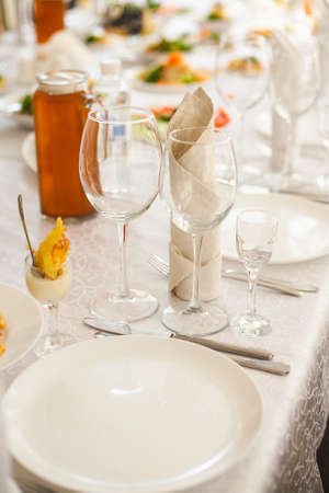 flatware: Table served with different food and flatware. Beautiful table ready for guests. Vertical color image. Stock Photo