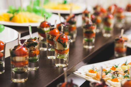party food: Catering for party. Close up of sandwiches, appetizers and fruit