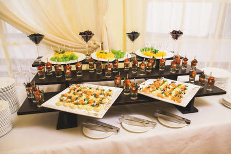 Catering for party. Close up of sandwiches, appetizers and fruit. Canape