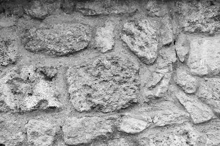 Old grunge stone background. Horizontal black and white color photography.