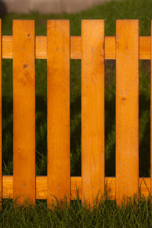 laths: Low-fence laths in tha garden Stock Photo