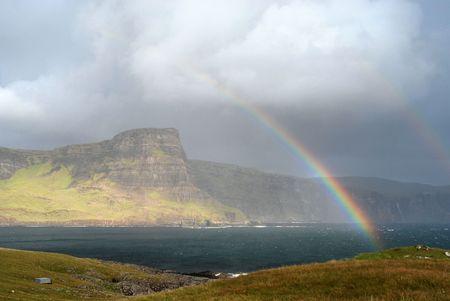 Scottish highlands with rainbow Stock Photo - 7813704