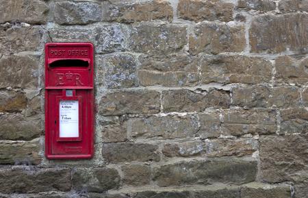 Post Box set in stone wall, English village photo