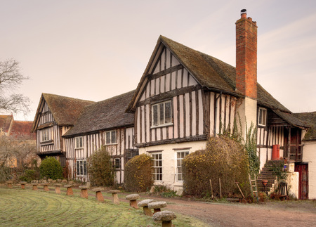 gabled: Double gabled, timber-framed Tudor period house, Warwickshire, England  Stock Photo