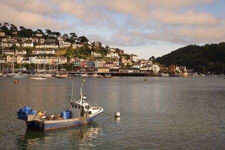 The sun setting over the Dart Estuary, Dartmouth, Devon, England  photo