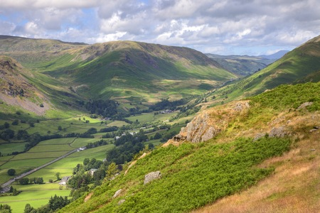 lion and lamb: Looking towards Grasmere from Alcock Tarn, Lake District, Cumbria, England  Stock Photo